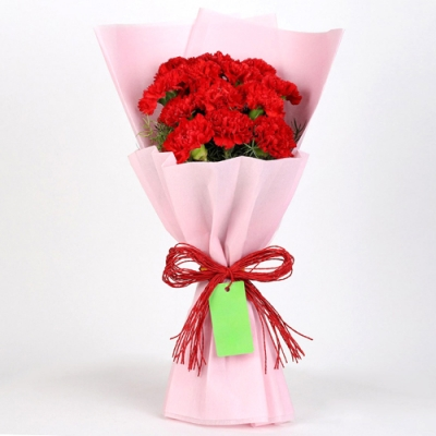 Send 12 Red Carnations Bouquet In Pink Paper to Bangladesh